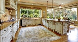 Large area rug in white rustic kitchen